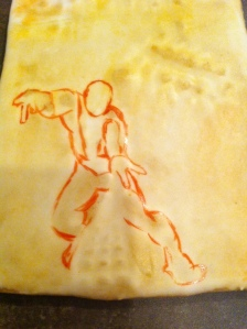 my beginning sketch of Spiderman (with the yellow food coloring wash behind it).